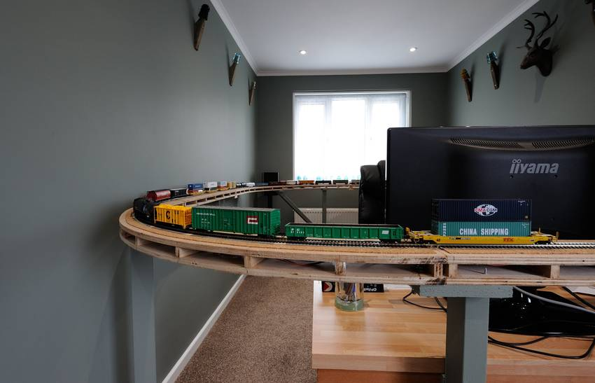 Trains and Railroads > Model train running round my office